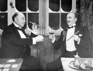 SILENT FILM STILL: DRINKING.