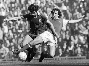 SOCCER TACKLE, 1976. Richie Powling of Arsenal FC (right) tackles a player of Ipswich