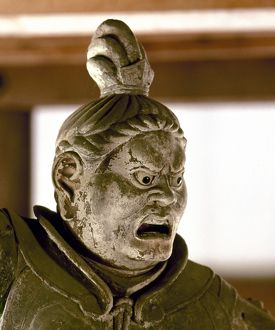 Statue of a warrior demigod, his face indicating wrath, one of the deva gods who