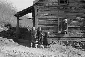 VIRGINIA: FAMILY, 1935. Fennel Corbin and two of his grandchildren outside a home