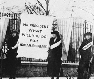 WHITE HOUSE: SUFFRAGETTES. Suffragettes holding a sign that reads 'Mr