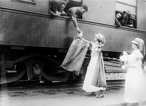 WORLD WAR I: RED CROSS. American Red Cross workers providing water and mail service