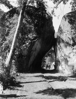 YOSEMITE: ARCH ROCK, c1913. A horse drawn carriage traveling through Arch Rock