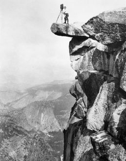 YOSEMITE: GLACIER POINT. William Henry Jackson photographing from a rock ledge