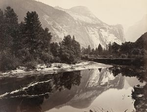 YOSEMITE: NORTH DOME. Reflection of trees and mountains in a stream with North